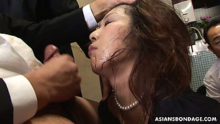 Lusty Japanese housewife Aoi Wajo gets mouthfucked right in the kitchen
