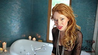 Redhead MILF with an amazing body in the shower