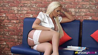 Mouth watering seductress in white stockings Lucy Zara shows off her pussy upskirt
