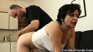 Granny in white lingerie swallowing two cocks after pussy