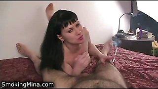Hot girl smoking cigarettes sucks a lucky cock