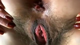 Pregnant babe with hairy bush and HUGE pussy lips fucks her asshole