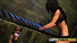 Cruel mistress playing with female slave