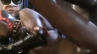 Ebony in leather butt fucked while sucking cock