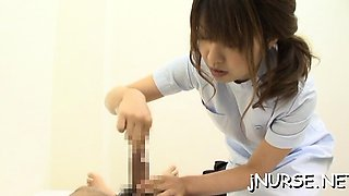 Sexy oriental nurse crushes balls and gives a steamy footjob