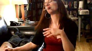 Brunette babe giving handjob while smoking