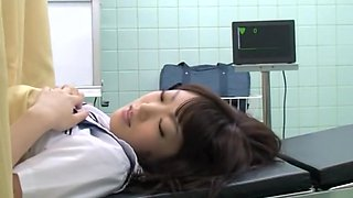 Noisy oriental schoolgirl getting fingered by her doctor on the medical bed