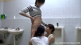 Slutty Japanese bitches approach a guy and suck his dick