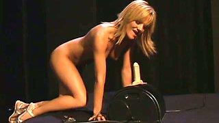Gigi Ferari licks a realistic dildo after jumping on it