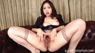 Elegant Japanese pornstar shows off her hairy twat close up