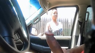 Cute black hooker checks out his stroking in the car