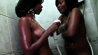 2 big booty African share a hot shower in this homemade