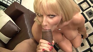 A milf with a sexy ass is getting a big black cock inside her mouth