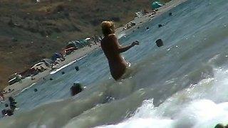 Voyeur video of nude girls having fun on a nudist beach