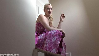 Tall blonde in purple dress allows a down blouse flashes