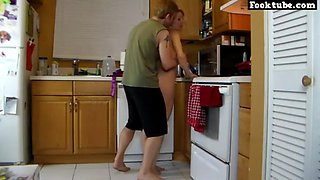Hot milf in kitchen