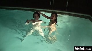 Two girls like to relax in the pool