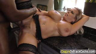 Mature slut Amber Lynn fully satisfied by a group of gigantic black rods