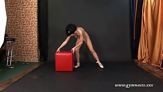 amazingly acrobatic rina sunkor drills her pussy with glass dildo