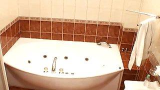 Superb busty redhead voyeur babe Atlantida taking a bath on