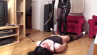 crossdresser get spanked on floor