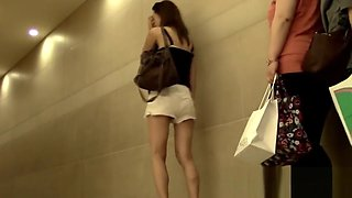 Beautiful and sexy Japanese chicks piss in public toilet