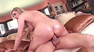 Busty blonde milf Tanya rides a stud's cock