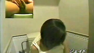 Toilet cam closeups with chick rubbing her big clitoris