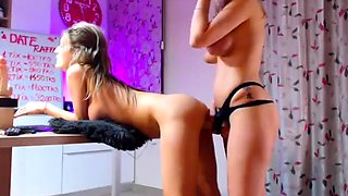 Two ravishing blonde lesbians having fun with a strap-on toy