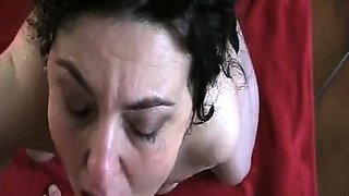 Stacked mature wife takes a hot load of piss in her mouth