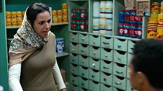 Pretty Arab woman in shop