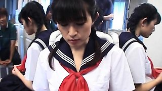 Japanese schoolgirl fucks her bushy pussy with toy