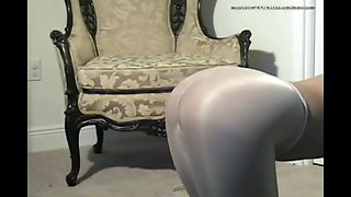 Teen Masturbates through white shiny pantyhose