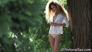 Classy model masturbating in outdoor action