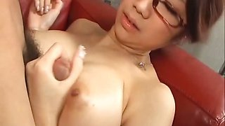Japanese cougar Fuuka Takanashi in glasses sucking cock
