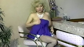 Sassy and appetizing blonde cougar with enormous breasts