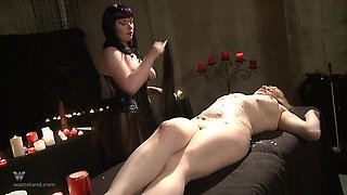 Blonde hottie screams while a mistress drills her cunt with candles