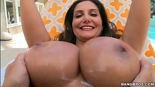 ava addams takes some lotion on her huge 34dd tits