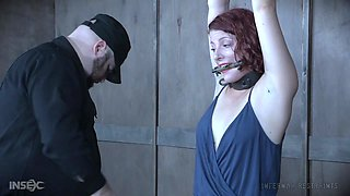 Redhead curvy slave babe Kel Bowie has her tits abused in bondage