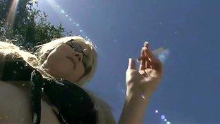 Smoking blonde in glasses