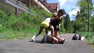 Two young mistress boots kicking trampling and humilation (1)