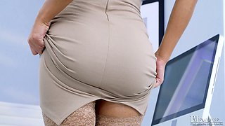 Leggy secretary in stockings Angel Wicky gets naked in the office