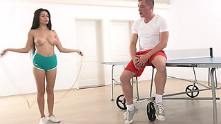 Busty brunette Sherill Collins enjoys getting fucked by her trainer