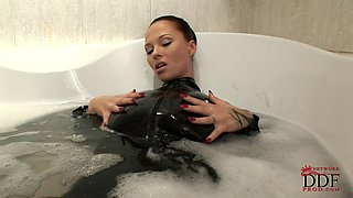 Nasty brunette Dominno is masturbating in the bathroom