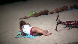 Nudist beach voyeur shoots naked babes sunbathing
