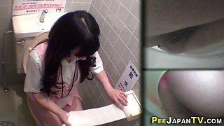 Asian whores filmed while peeing in the toilet
