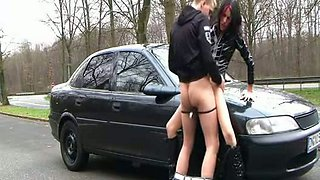 German latex slut serves her client near a car