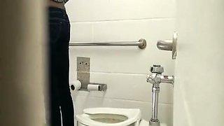 Ebony girl spied in public toilet peeing