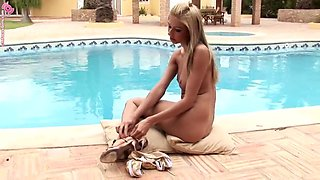 sexy blonde shows off her great body right by the pool