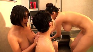 Two voluptuous Japanese cougars take turns on a hard dick
